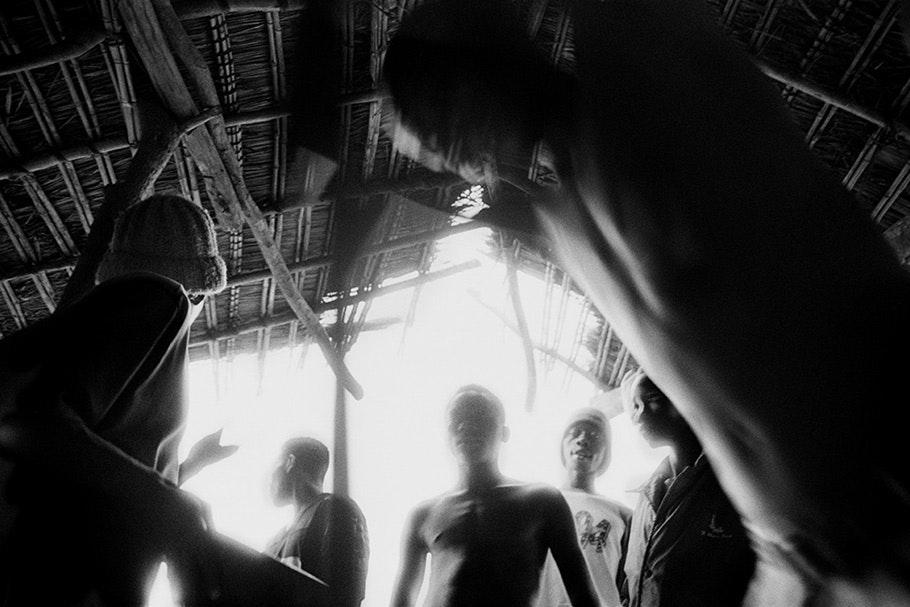 Backlit soldiers viewed from below.
