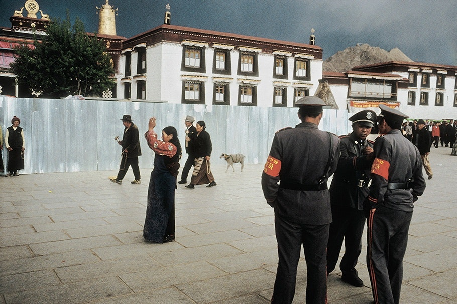 Police and pilgrims in an outdoor square.