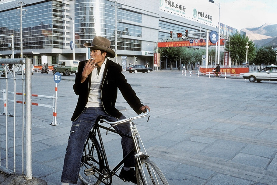 A man on a bicycle.