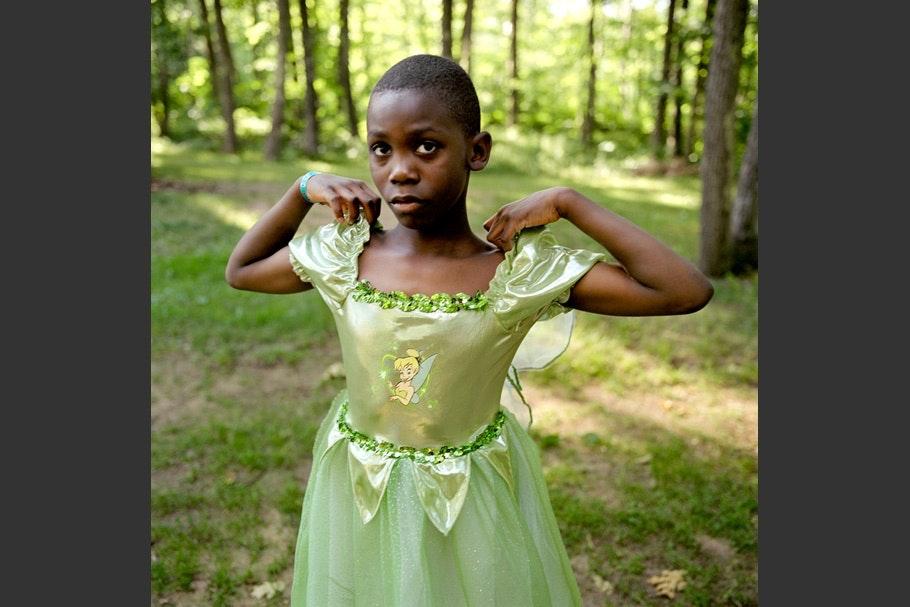 Child in green Tinker Bell dress.