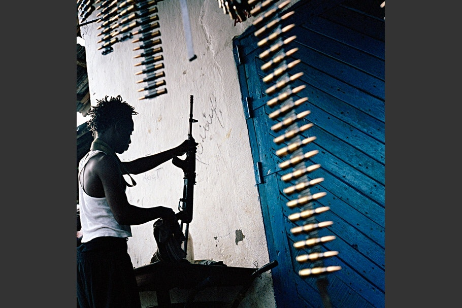 A man cleaning a gun.
