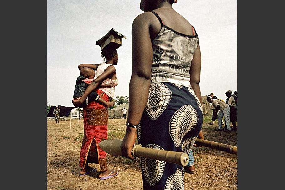 Women carrying ammunition.
