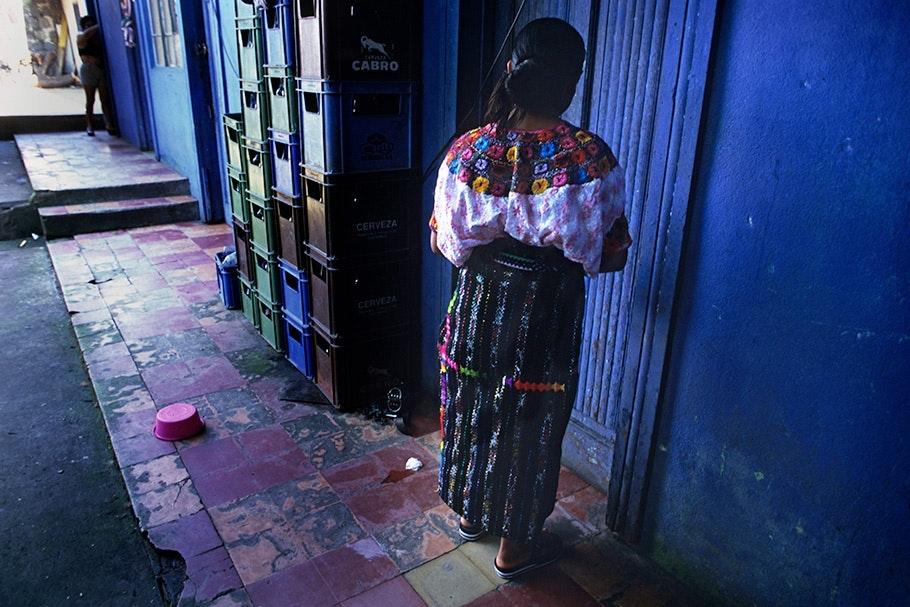 Woman at a door.