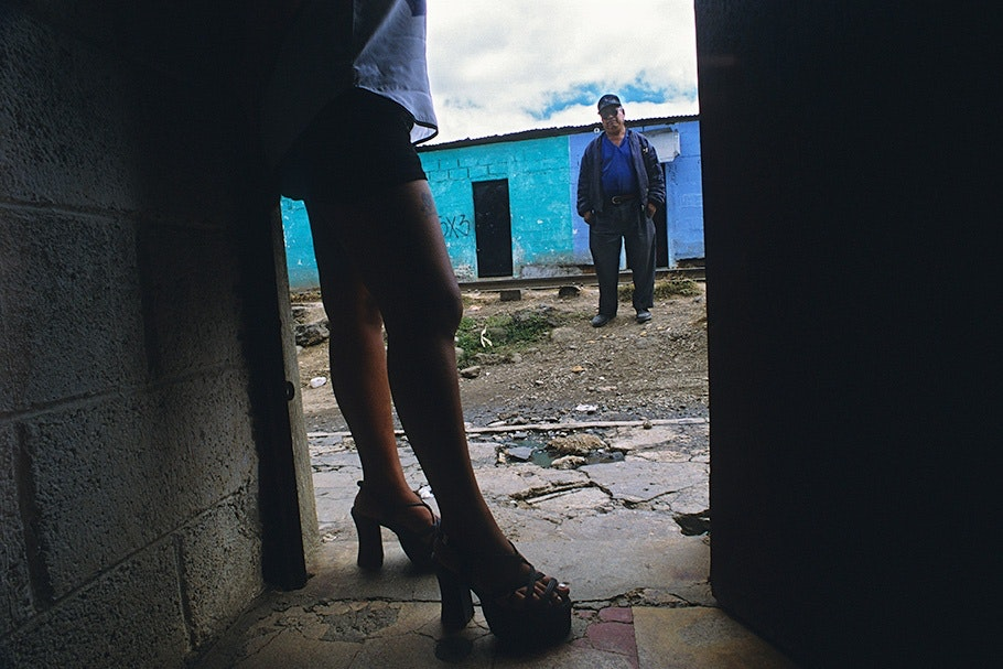 A woman's legs in a doorway.