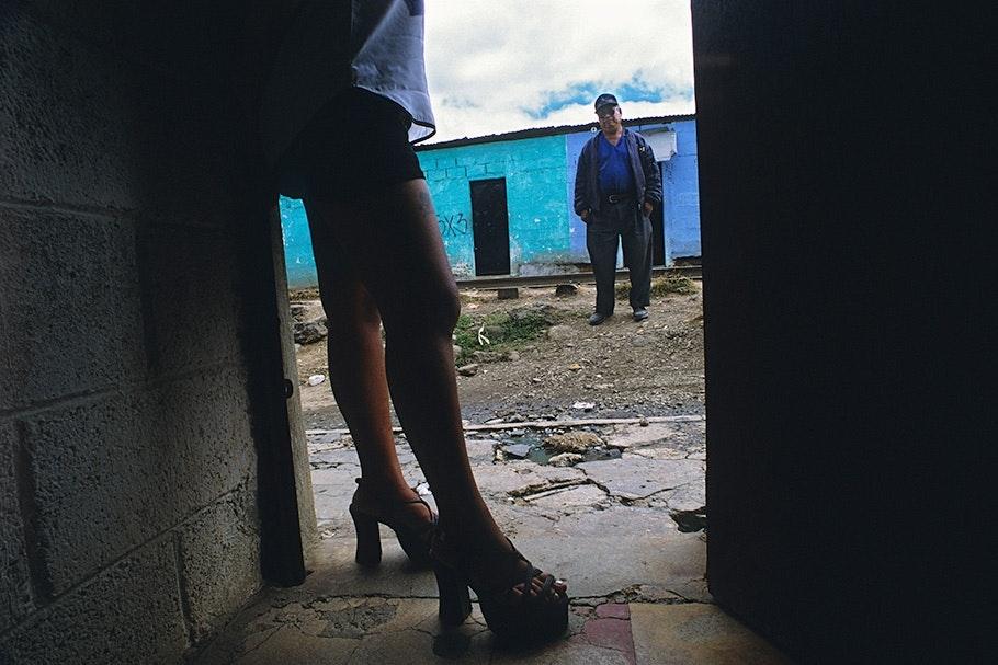 A woman's legs in a doorway.