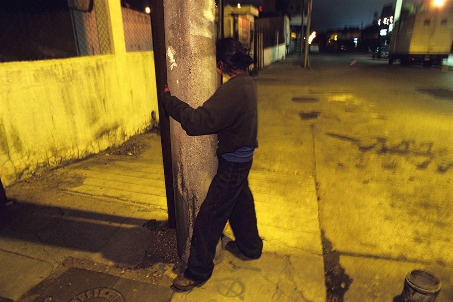 Woman holding a pole.