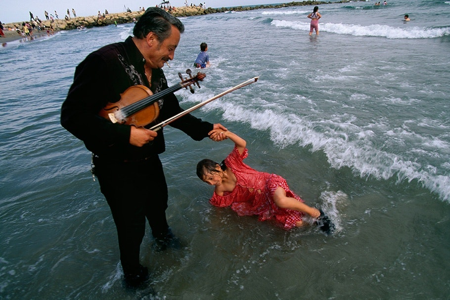 A violist and a girl in water.