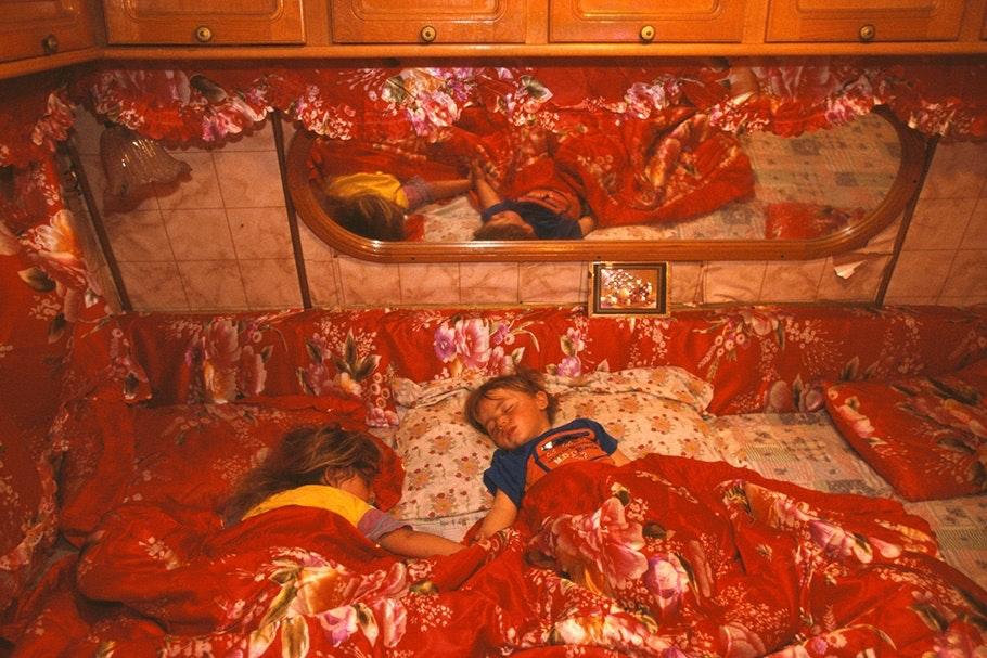 Children asleep in bed.