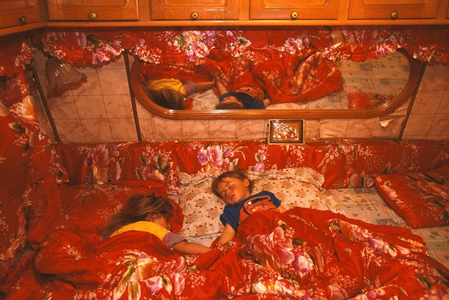 Children asleep in bed.
