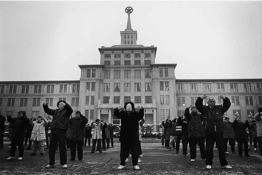 A group practicing Falun Gong outside of a building.