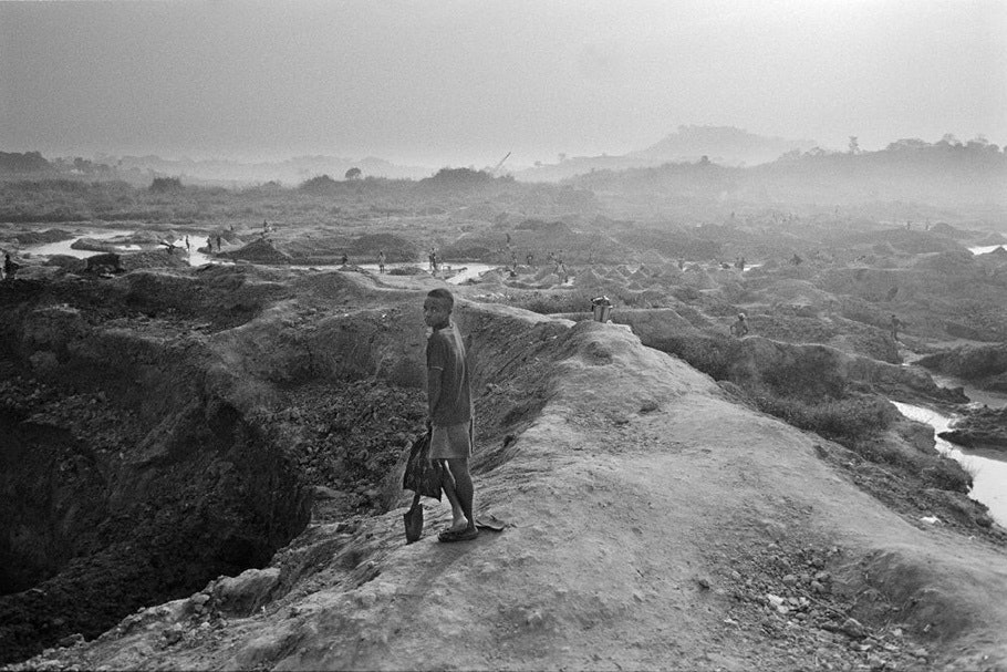 A child overlooking a mine.