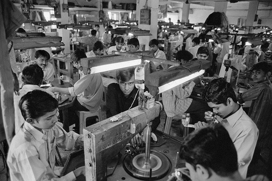 Workers polishing diamonds.