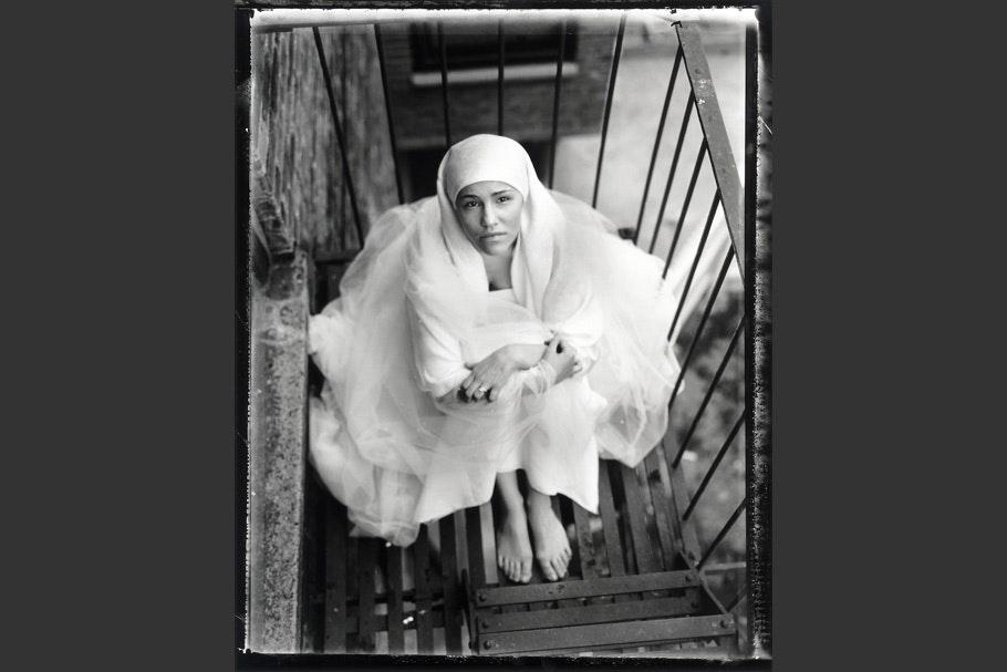 Muslim teenage girl on a fire escape.