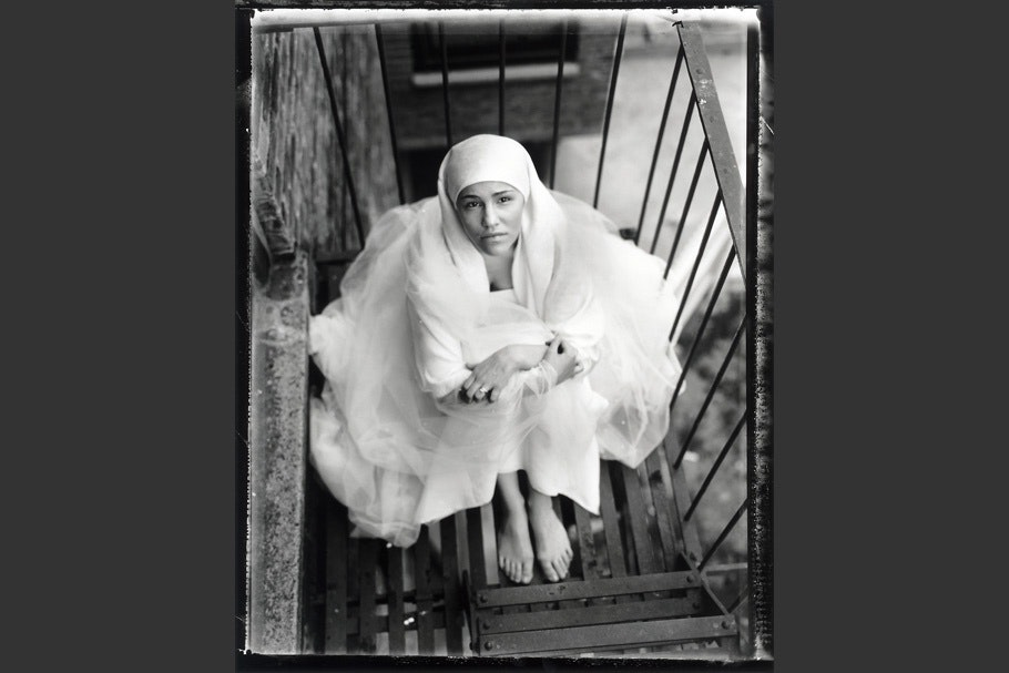 Muslim teenage girl on a fire escape.