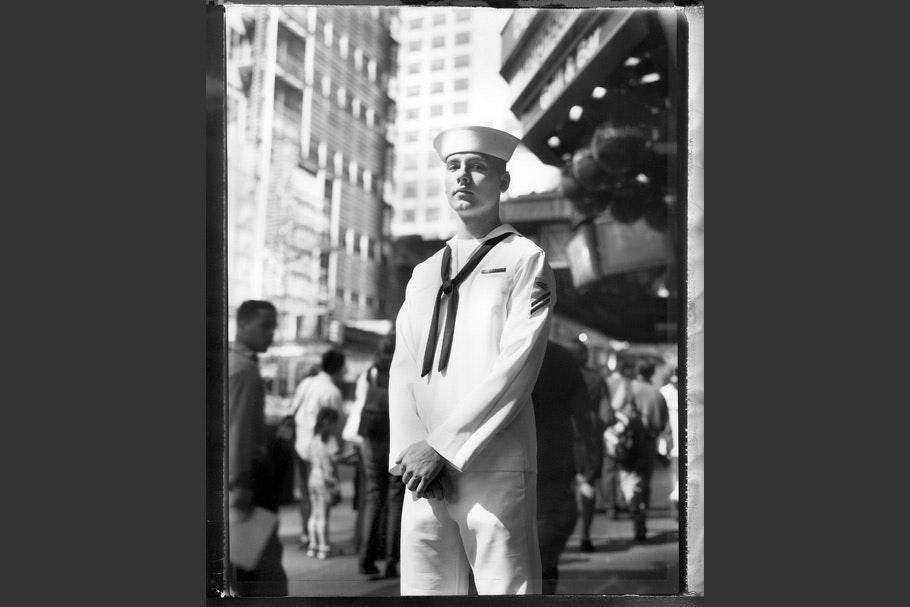 A sailor in uniform.