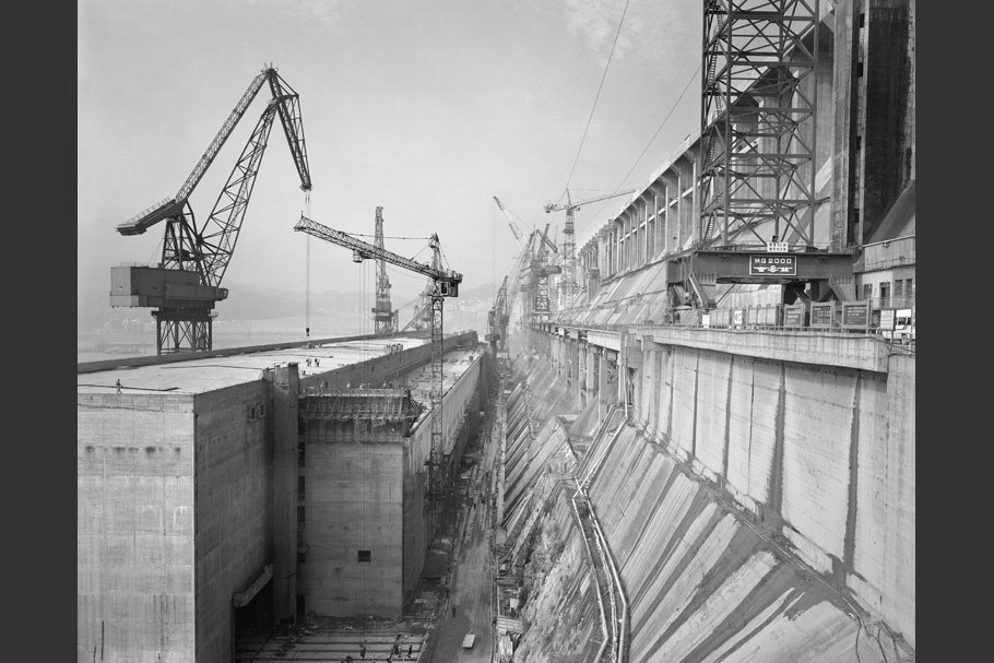 View of damn under construction, with cranes.