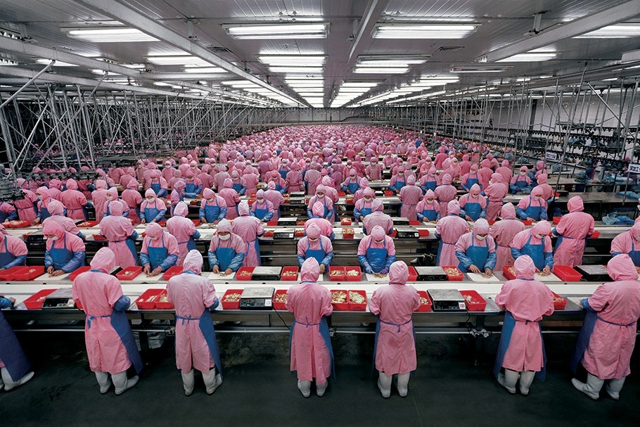 Factory workers in pink uniforms.