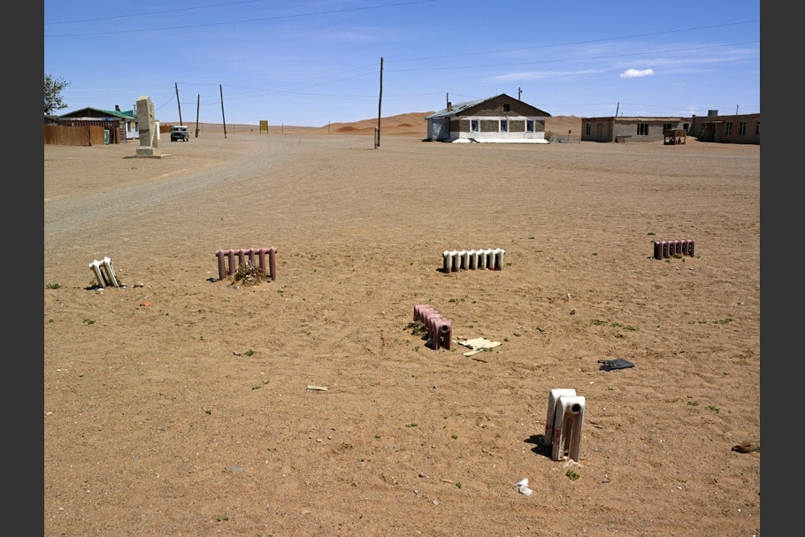 Radiators scattered around a sandy landscape.