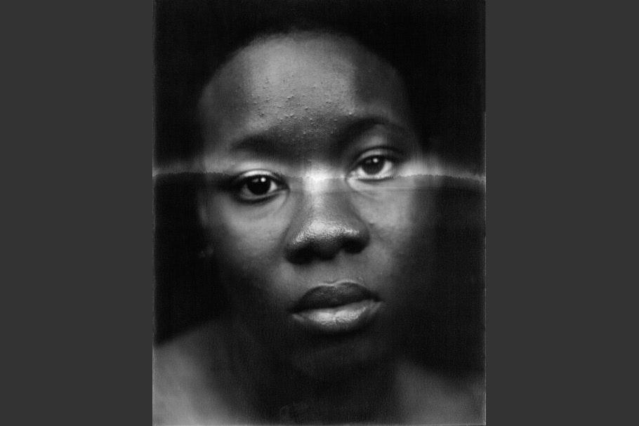 Self-portrait with light across eyes.