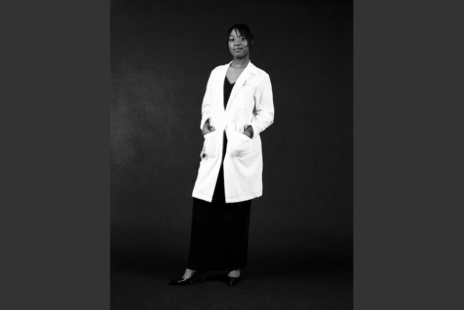Woman in white coat.