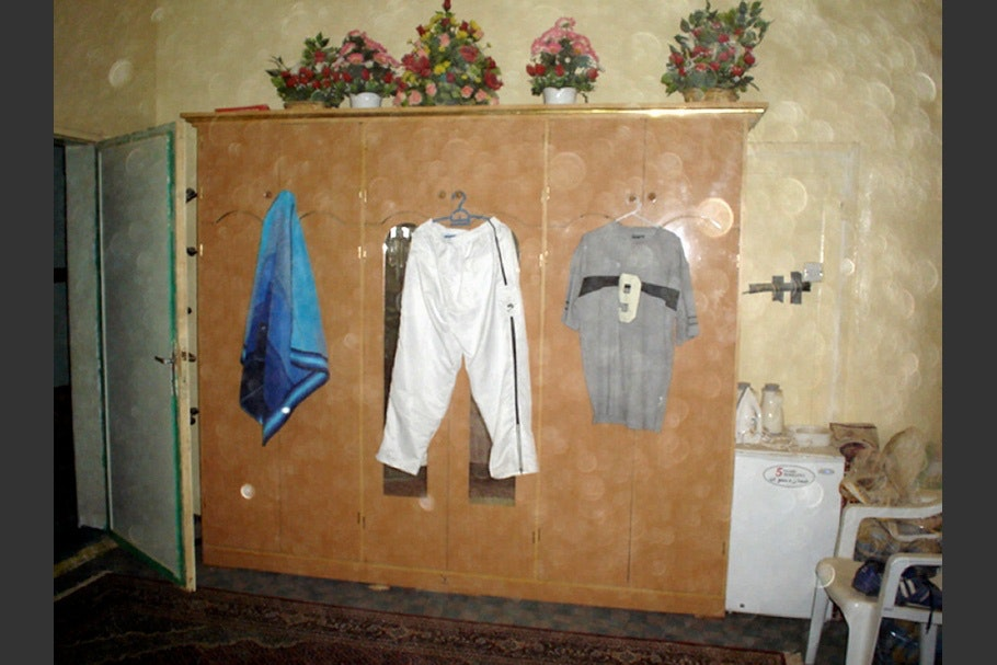 Interior with clothes on hangers.