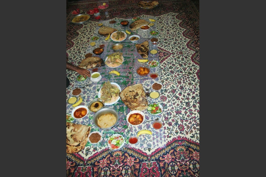 A meal atop a patterned tablecloth.