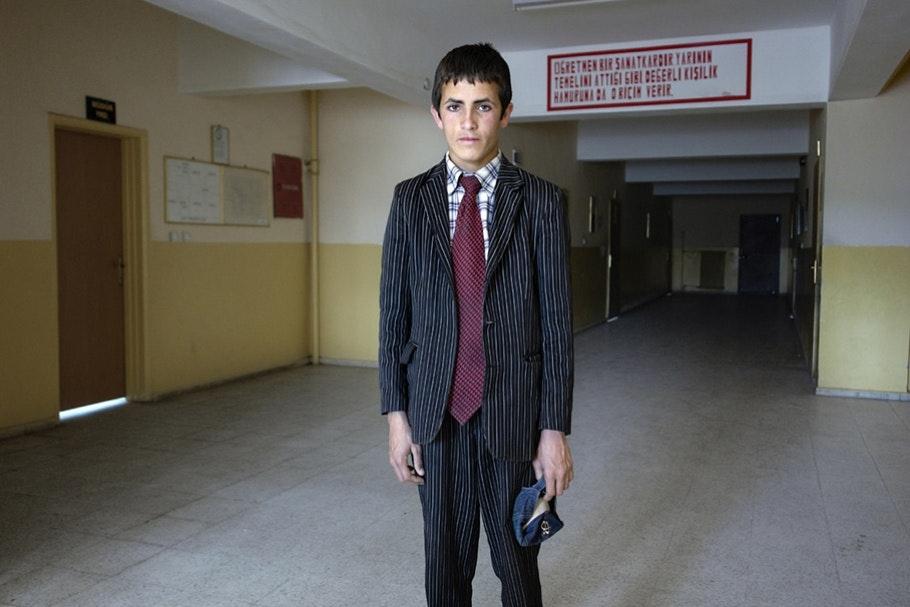 Boy in suit.