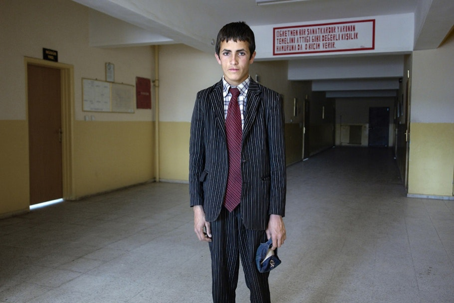Boy in suit.