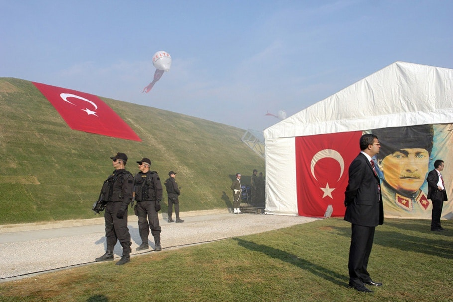 Guards stand near large tent
