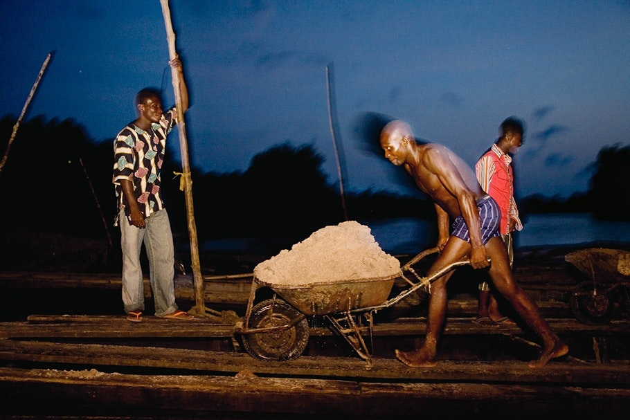 Man with wheelbarrow.