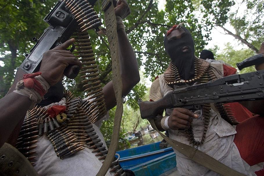 Men with machine guns and masks.