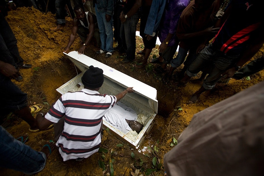 White coffin being buried.