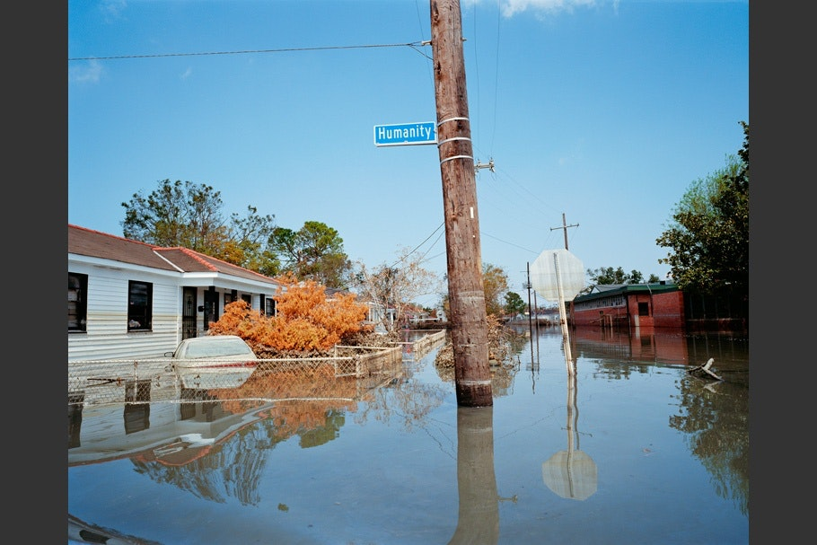 Flooded street with Humanity Street sign.