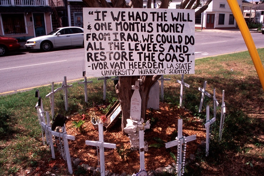 """If we had the will…"" sign surrounded by crosses."