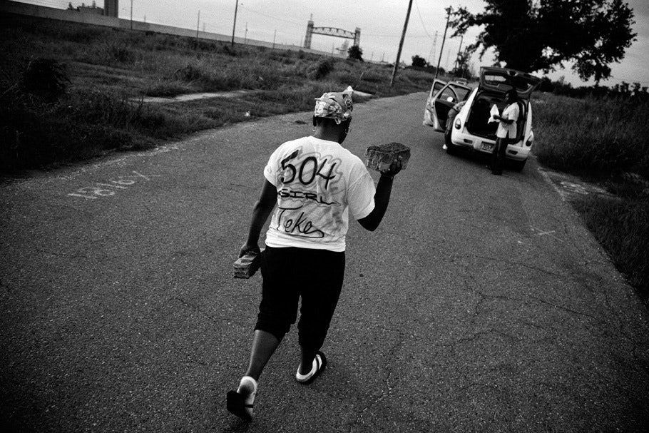 "Woman walking down street with T-shirt with ""504"" on back."