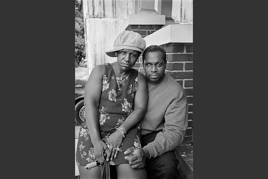 Woman sitting on man's lap.