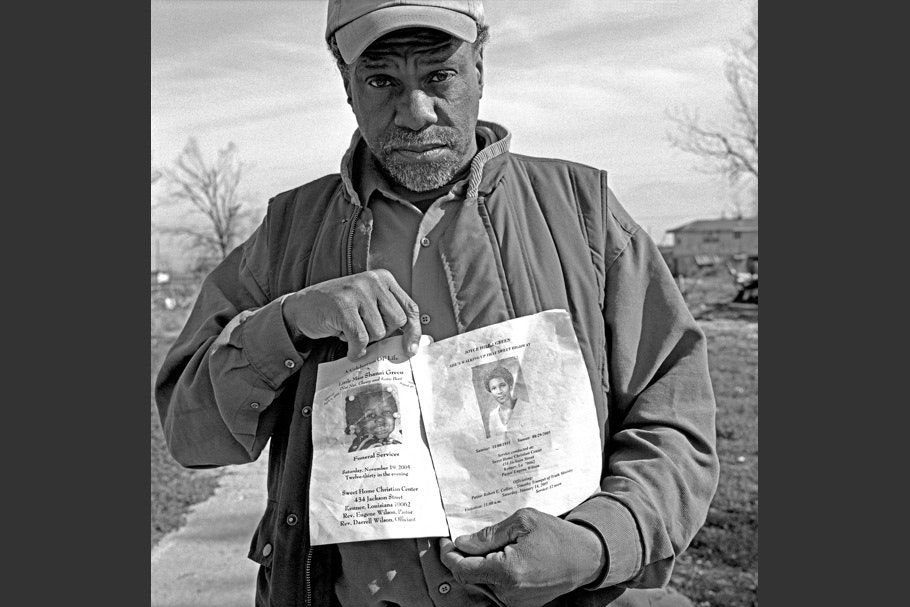Man holding papers in front of him.