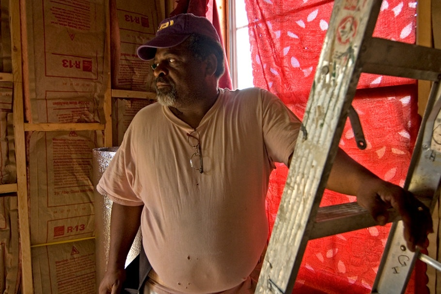 A man standing by a ladder