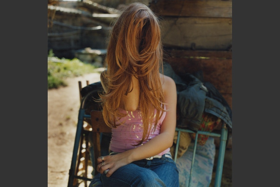 Woman with hair covering face.