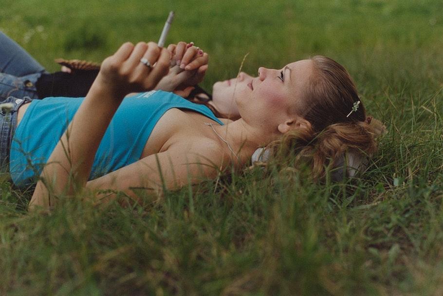 Women lying in grass.