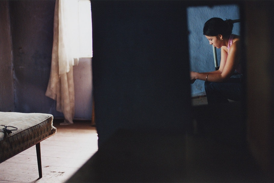 Woman framed in blue on right side of image.