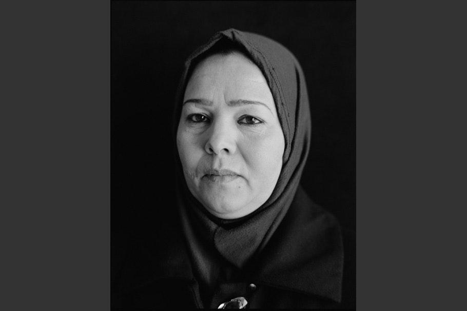 Woman with headscarf.