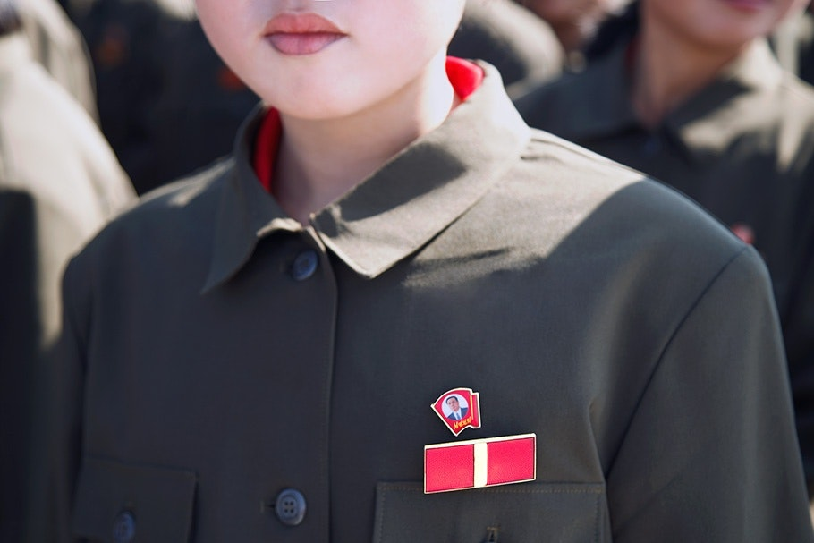 Shoulders and lips of female soldier.