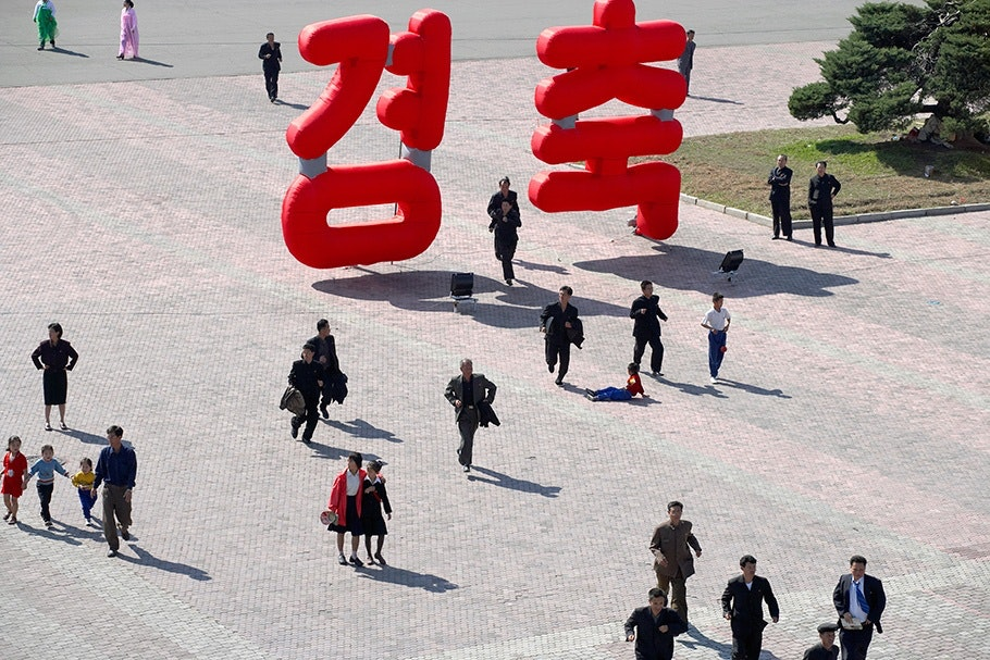 Street scene with large red letters.