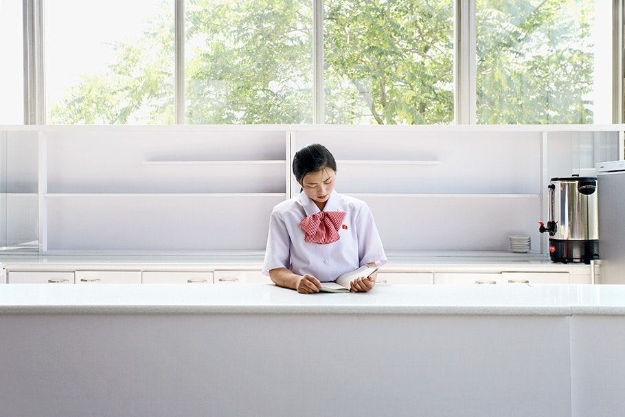 Woman in white at desk.