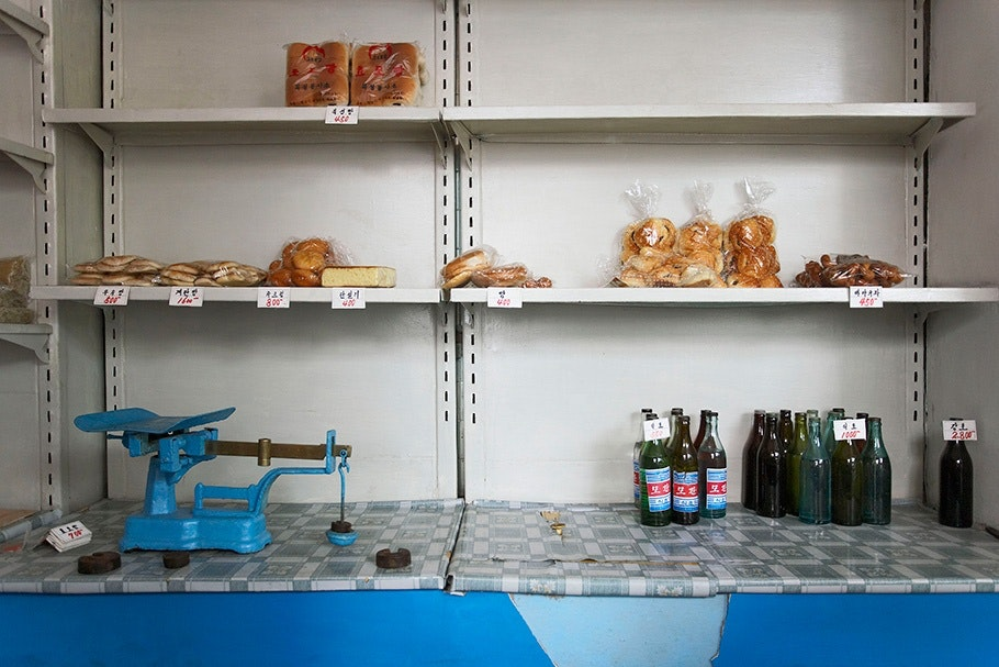 Shelves with bread and scale.