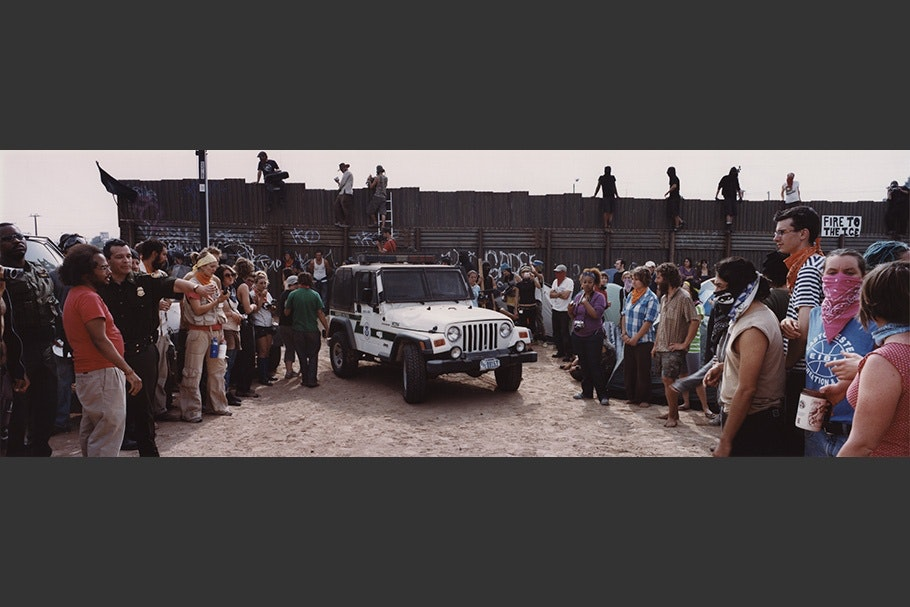 Crowd with white jeep.