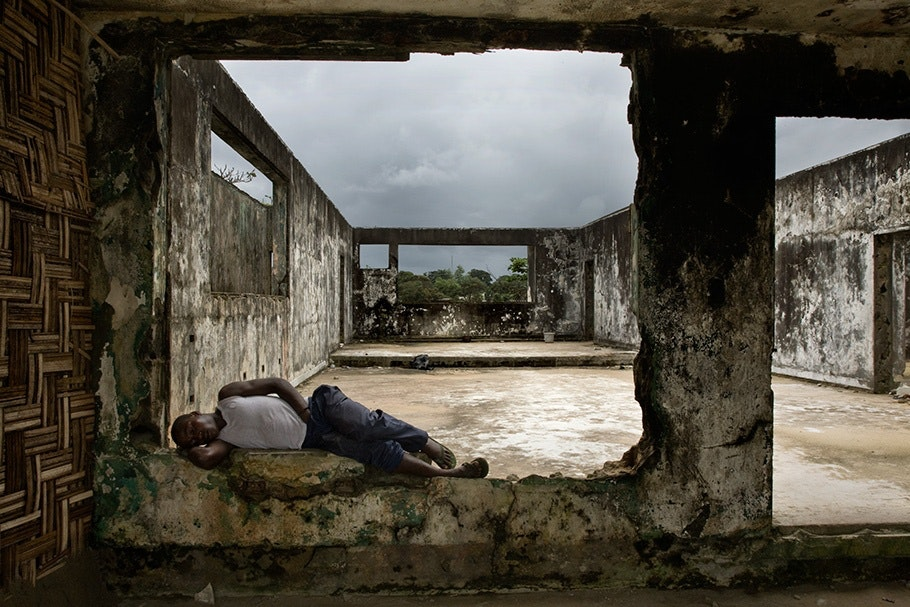 Person lying in roofless building.