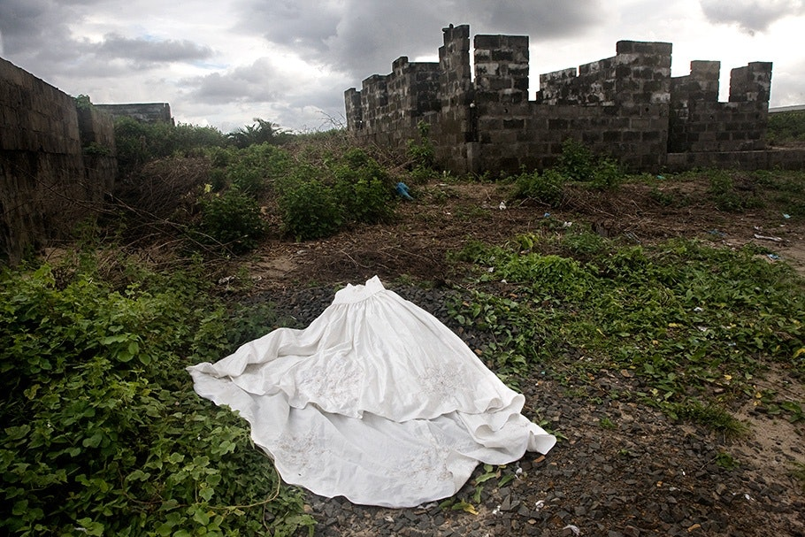 Wedding dress on the ground.