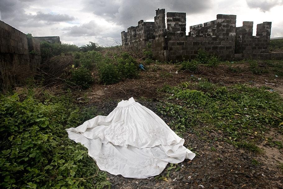 Wedding dress on the ground.